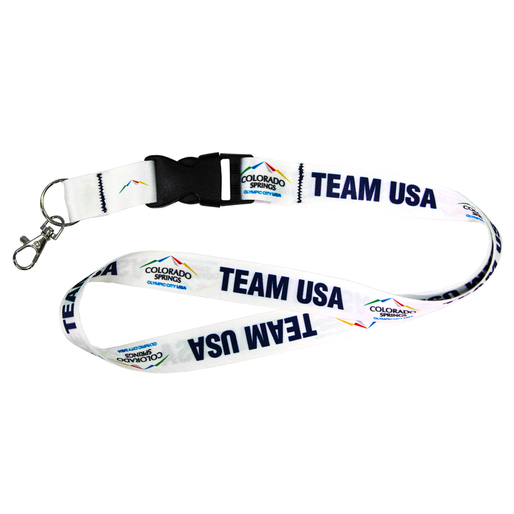 White lanyard with a black detachable buckle decorated with with official City of Colorado Springs: Olympic City USA and Team USA logos and wordmarks