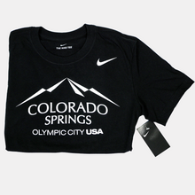 Load image into Gallery viewer, Folded in half black short sleeve T-shirt with a white version of the city of Colorado Springs: Olympic City USA logo screen printed onto it. White Nike logo printed underneath the shoulder.