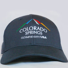 Load image into Gallery viewer, Front view of navy baseball hat with Colorado Springs: Olympic City USA logo embroidered on it