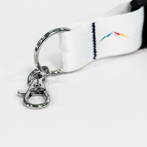 Up close view of the sliver-colored trigger hook on a white lanyard