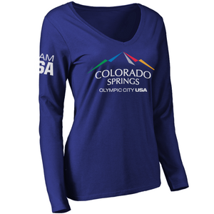 Dark blue long sleeve v-neck shirt with full color city of Colorado Springs: Olympic City USA logo printed in the upper, center of the shirt. Team USA printed on the left upper sleeve.