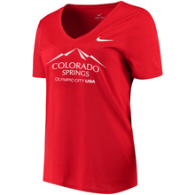Load image into Gallery viewer, Red short sleeve v-neck t-shirt with white version of the city of Colorado Springs: Olympic City USA logo printed on front. White Nike logo under right shoulder. Team USA and Nike tags attached to right sleeve.