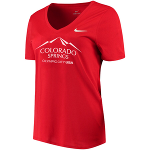 Red short sleeve v-neck t-shirt with white version of the city of Colorado Springs: Olympic City USA logo printed on front. White Nike logo under right shoulder. Team USA and Nike tags attached to right sleeve.