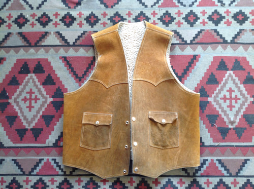 Vintage Sherpa leather vest, size medium/large, 34inched across