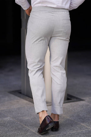 SLIM PLEAT FRONT STRETCH TROUSERS IN GREY