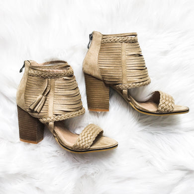 Braided strap heeled sandal with tassels