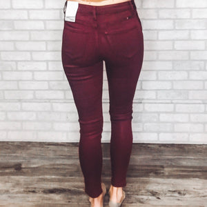 High rise coated colored denim jeans