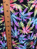Multi all over marihuana leafs on poly spandex fabric sold by the yard