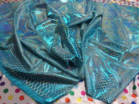 Turquoise Iridescent Dragon Scales on a Nylon 2 way stretch Spandex Sold by yard