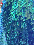 TURQUOISE IRIDESCENT SEQUINS-DRAGON SCALES EMBROIDER ON A MESH-SOLD BY THE YARD.