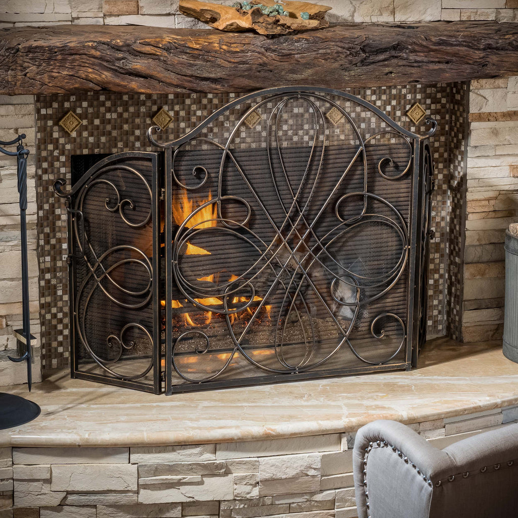 The Rosalinda Fireplace Screen is beautifully crafted out of iron and highlights ornate design work on the face of the screen. The sophistication of this fireplace screen adds a refined look to any fireplace filled room. Features: Includes one fireplace screen Constructed with black brushed gold finish wrought iron Fea