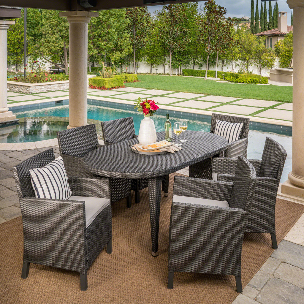 Crete Outdoor 7 Piece Wicker Oval Dining Set with Water Resistant Cushions