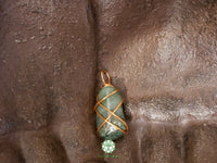 Moss Agate Wire Wrapped Pendant 1.1x.5 inches (WWP103)