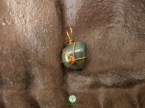 Moss Agate Wire Wrapped Pendant .9x.5 inches (WWP113)