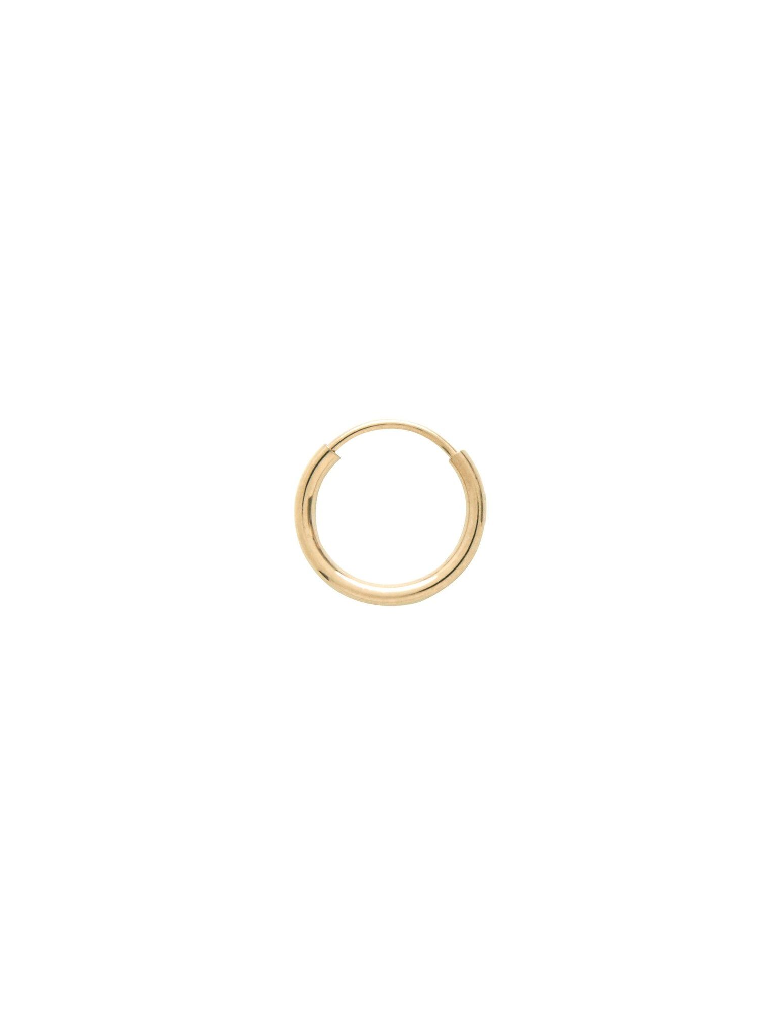Essential minimal gold hoop earring that wears close to the lobe. This endless flexible tube design can be tricky and are better intended for extended wear.   14k yellow gold 10mm diameter  1mm thickness Sold as a single