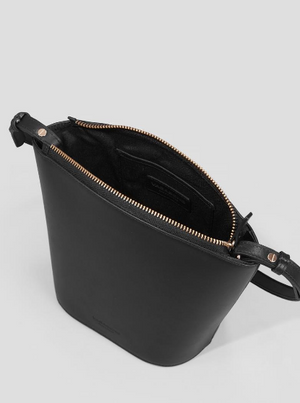 "Top view: Modest sized cross body bag made from smooth black leather. Half-moon shaped silhouette. Gold tone metal top zipper closure. Open compartment inside pocket. Removable slender shoulder strap.   Height: 7"" Width: 9.5"" Depth: 3.5"" Shoulder strap drop length: 53 cm"