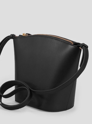 "3/4 front view: Modest sized cross body bag made from smooth black leather. Half-moon shaped silhouette. Gold tone metal top zipper closure. Open compartment inside pocket. Removable slender shoulder strap.   Height: 7"" Width: 9.5"" Depth: 3.5"" Shoulder strap drop length: 53 cm"