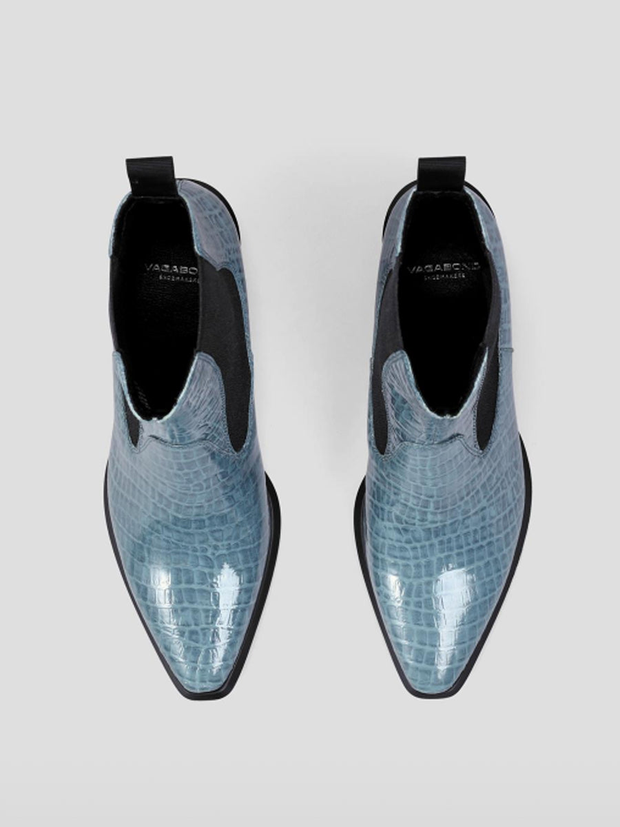 "Top View: This ankle-high sleek Chelsea boot is crafted from a dusty blue croc-embossed patent cow leather. Light western influences including a squared toe and Cuban heels measuring 2.25"". Contrasting black, elastic side panels and back pull tabs for easy pull on and off. Padded footbed. Certified organic cotton lining."