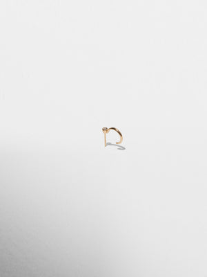 side view of 14k yellow gold post huggie earring. Sold as a single. White diamond. Made in USA. Recycled metal.
