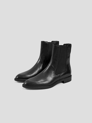 3/4 front view: Designed to capture a classic feel, these Frances Chelsea boots are a true wardrobe staple. This firm everyday favorite is crafted from smooth black leather, have slightly pointed toes and are set on low heels measuring 29mm. The elasticated side panels ensure optimum comfort and ease.