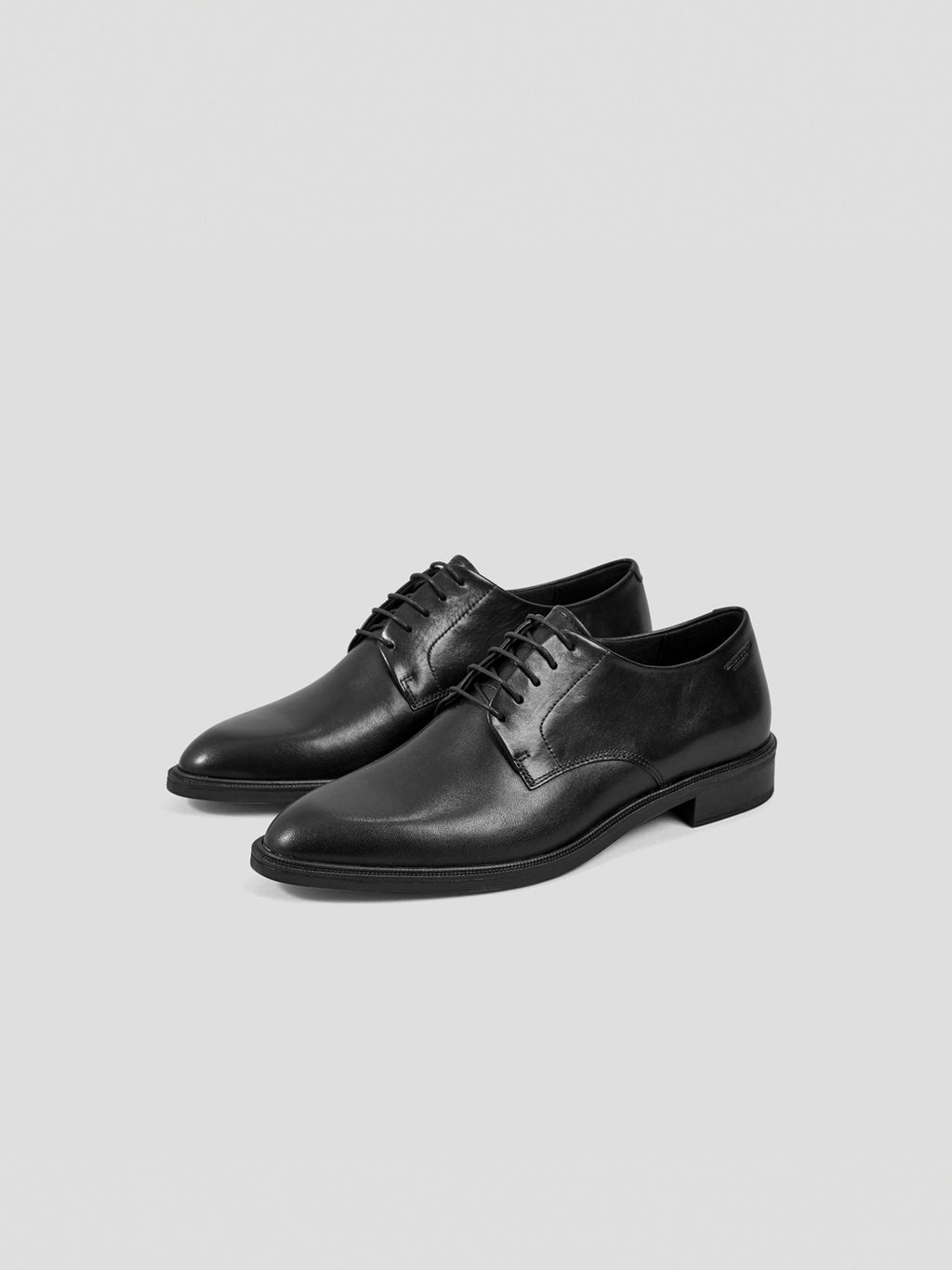 3/4 front view: Take on the new season in a pair of classic and sophisticated derby lace-up shoes. These black leather Frances shoes have a slender last and are set on a slightly raised heel, measuring 29mm. The sleek design features a pointy toe and timeless derby lacing.