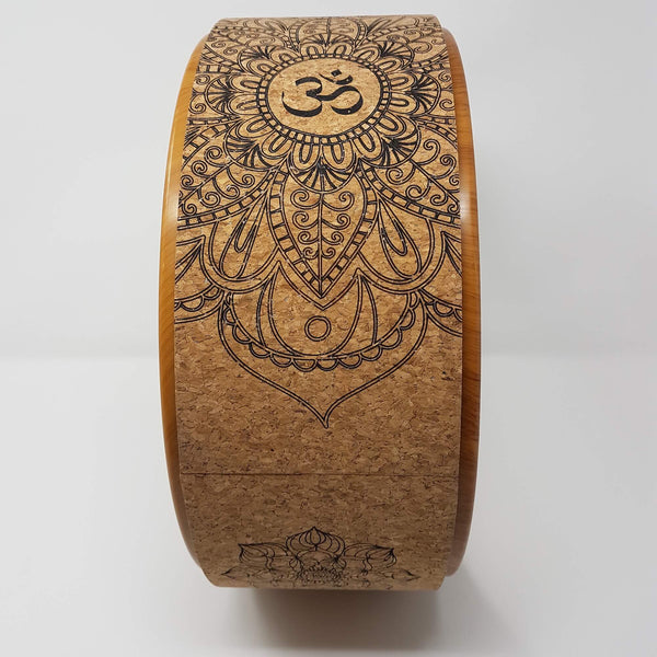 Bovoka Cork Yoga Wheel with Om yoga symbol representing  mind body and spirit.