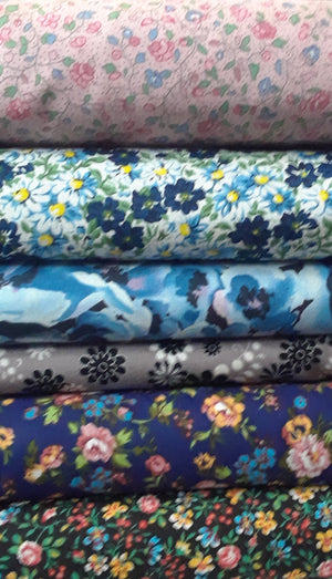 pink floral (small flowers), white blue yellow, grey black snowflake(no longer available) blue floral, black multifloral
