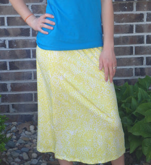 yellow and white print skirt