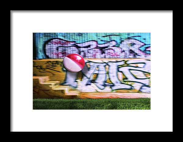 A Colorful Beach Ball in Mid Air Against a Graffiti Background at Griffith Park-Los Angeles.