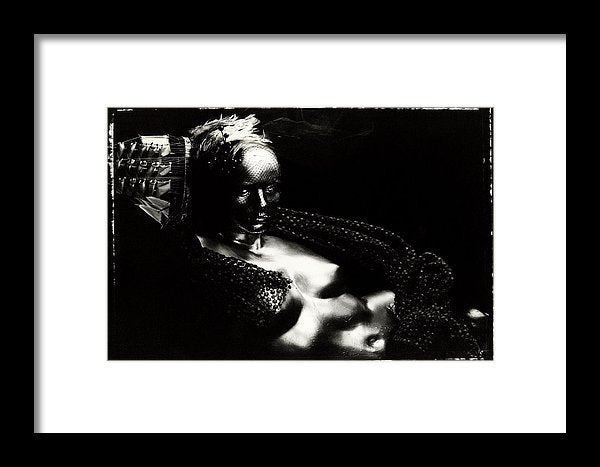 Horizontal Black and White Portrait, on Polaroid 55, of a nude, metallic mannequin torso with a Ship Hat and Feather Headpiece along the side of the Head-Framed Fine Art Print