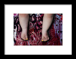Female Baby Legs and Yellow Painted Toenails on Graffiti Background- Framed Fine Art Print