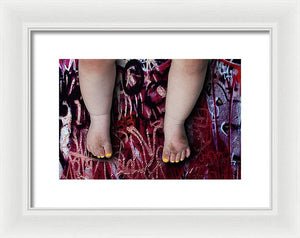 Female Baby Legs and Yellow Painted Toenails on Graffiti Background-Framed Fine Art Print