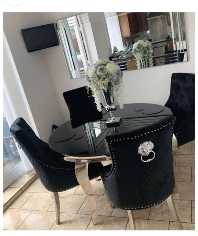 Black glass  top table with 4 black  knocker chairs