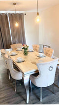 Cambridge smoked cream marble top with our Lara cream chairs