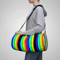 rainbow candy stripe duffle bag with stay curious, be wonderful. in pink.