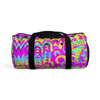 CMYK woof! duffle bag on bright magenta back ground.