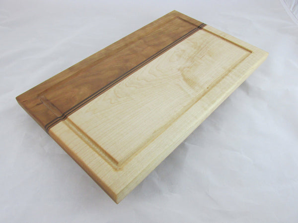 Hardwood cutting board with juice groove. maple and cherry chopping block with walnut accent. Great one of a kind wedding gift!