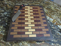 Large end grain cutting board made from solid hardwood maple, cherry, walnut, padauk, and purpleheart woods. great gift idea for the kitchen