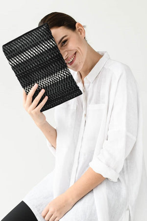 Clutch AUSTĖ No.34 in black and reflective