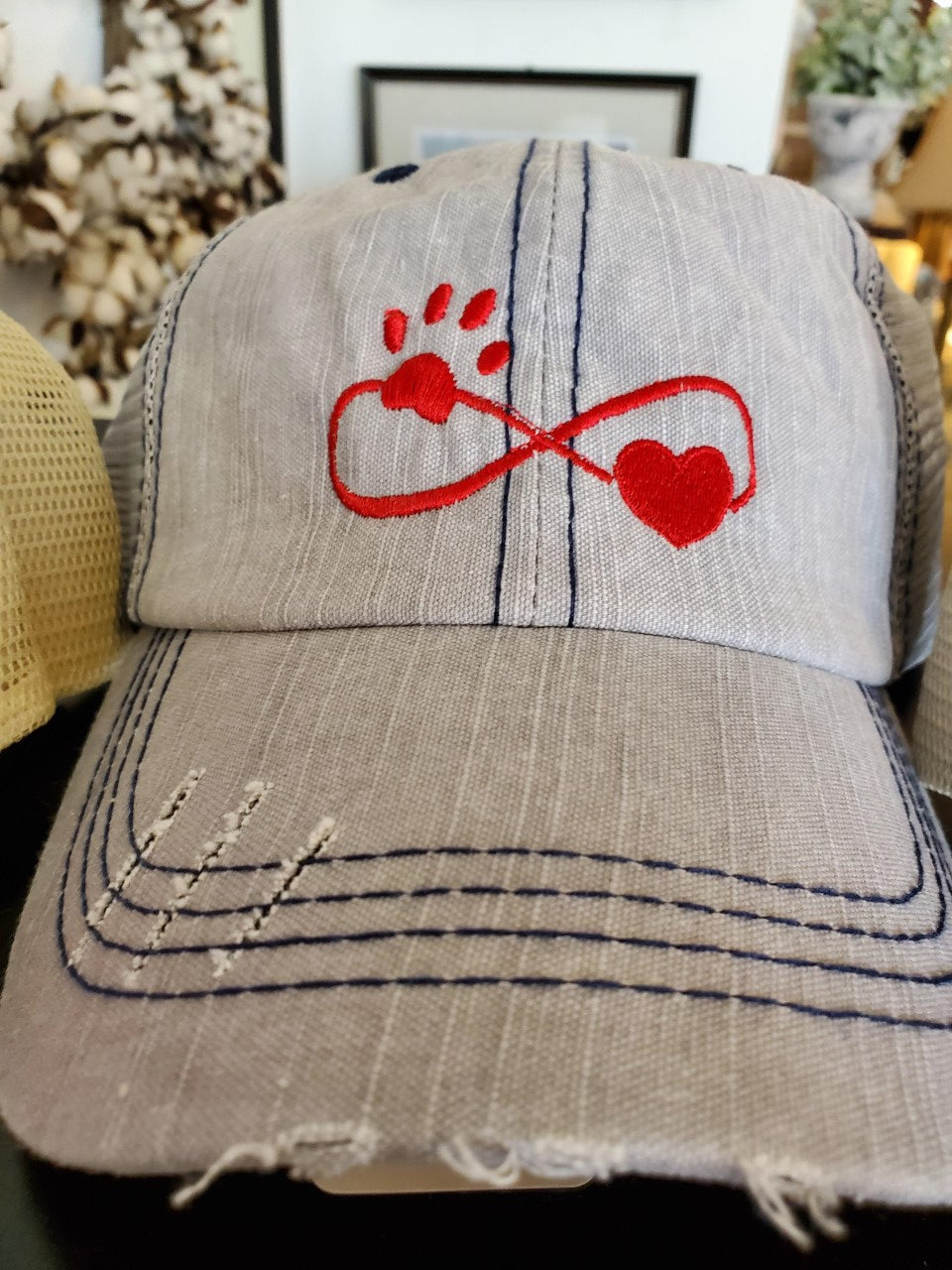 Embroidered Dog Paw Infinity Distressed Trucker Hat