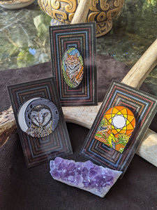 The Brady Tarot Enamel pins: the Hermit, the Empress, and the Sun
