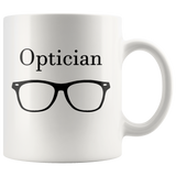 """Optician"" and black glasses on white mug"
