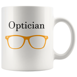 """Optician"" and orange glasses on white mug"