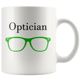 """Optician"" and green glasses on white mug"
