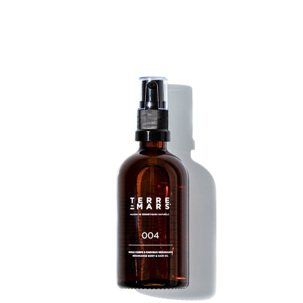 Amber glass 100ml bottle of resonance hair and body organic oil by French brand Terre de Mars