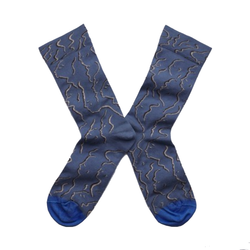 Cool socks designed by French brand Bonne Maison featuring the face profiles on denim background