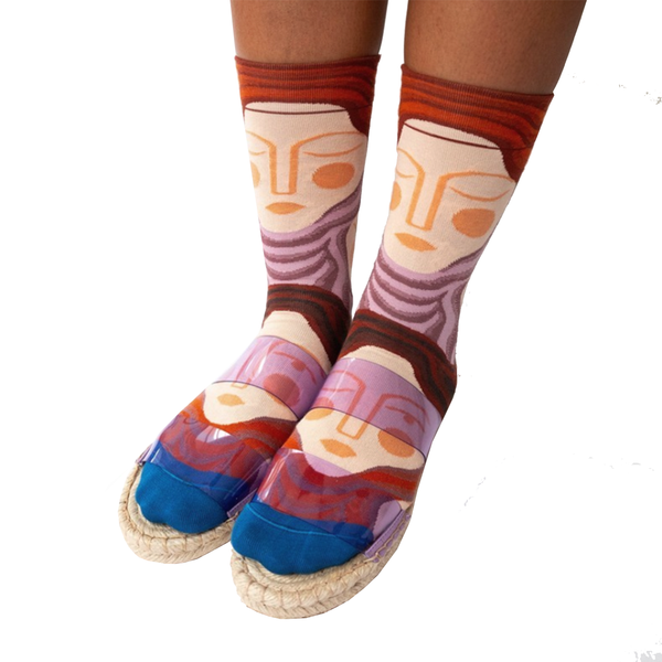 Close up of cool socks designed by French brand Bonne Maison featuring sleeping faces on a multicoloured background