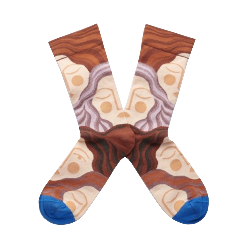 Cool socks designed by French brand Bonne Maison featuring sleeping faces on a multicoloured background