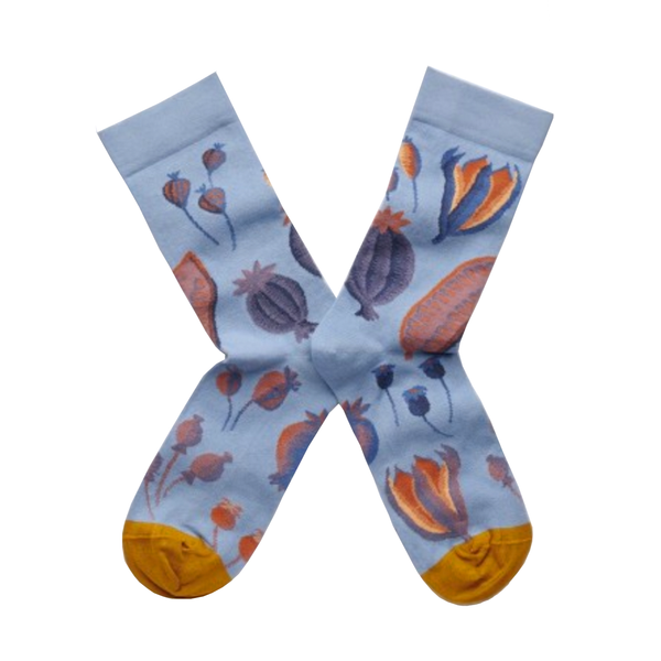 Cool socks designed by French brand Bonne Maison featuring different seeds on a stormy background