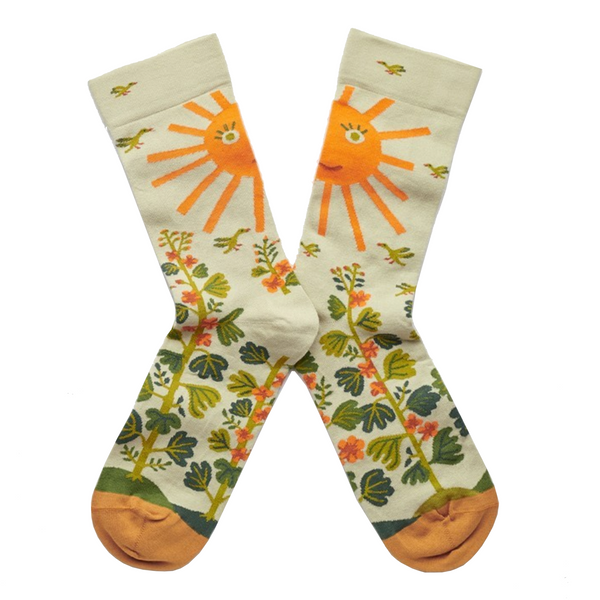 Cool socks designed by French brand Bonne Maison featuring the sun and sage leaves